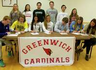Greenwich High School seniors pose for a photo to commemorate signing letters of intent to play sports at their colleges on Tuesday, November 18, 2014. Top row, from left, Antonia Lycouris, who will row at George Washington University; Natalie Paletta, who will play lacrosse at Cornell; Iain Edmunson, who will swim at Dartmouth; Thomas Dillinger who will swim at University of Pennsylvania; Andrew Bologna who will dive at University of Pennsylvania; Elizabeth Brown, who will row at George Washington University. Bottom row, from left, Devin McGrath, who will play baseball at College of the Holy Cross; Decker Curran, who will play lacrosse at the University of Michigan; Sylvie Brounstein, who will row at the University of Miami; Alex Slabbert, who will row at the University of Virginia; Alec Oropall, who will play lacrosse at College of the Holy Cross; Megan Slabbert, who will row at UCLA, and Isabel Meskers, who will row at Geroge Washington University.