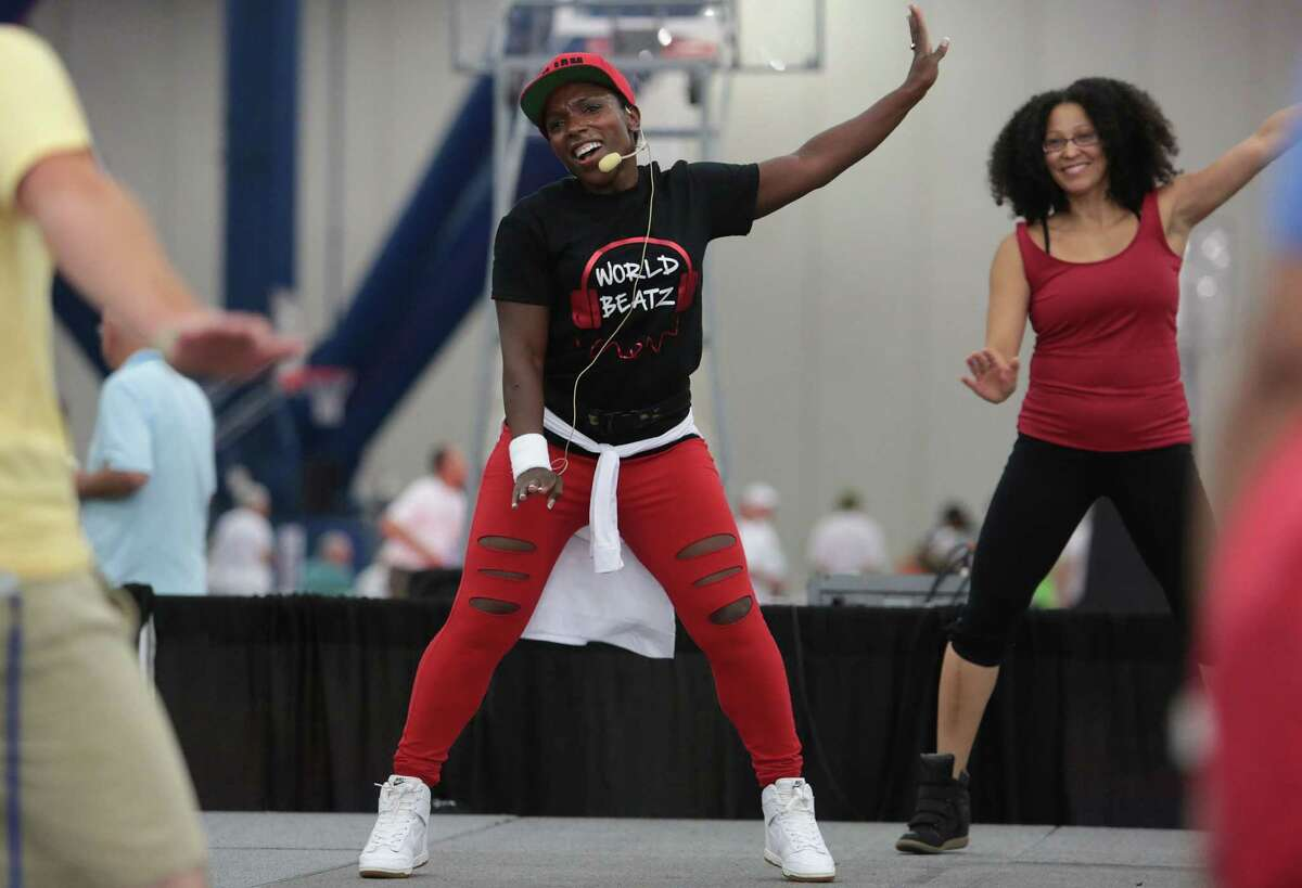 Denitra Bruer-Robinson and Jamaica Bowie lead a U-Jam class during the Transplant Games in Houston.