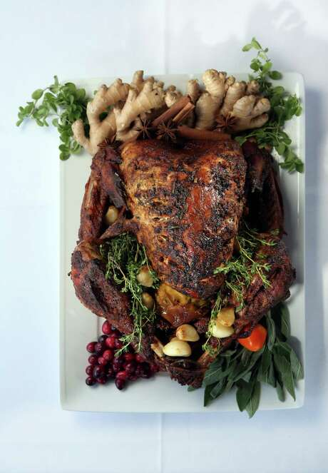 serving a Tandoori Turkey for Thanksgiving, which is a roasted turkey ...