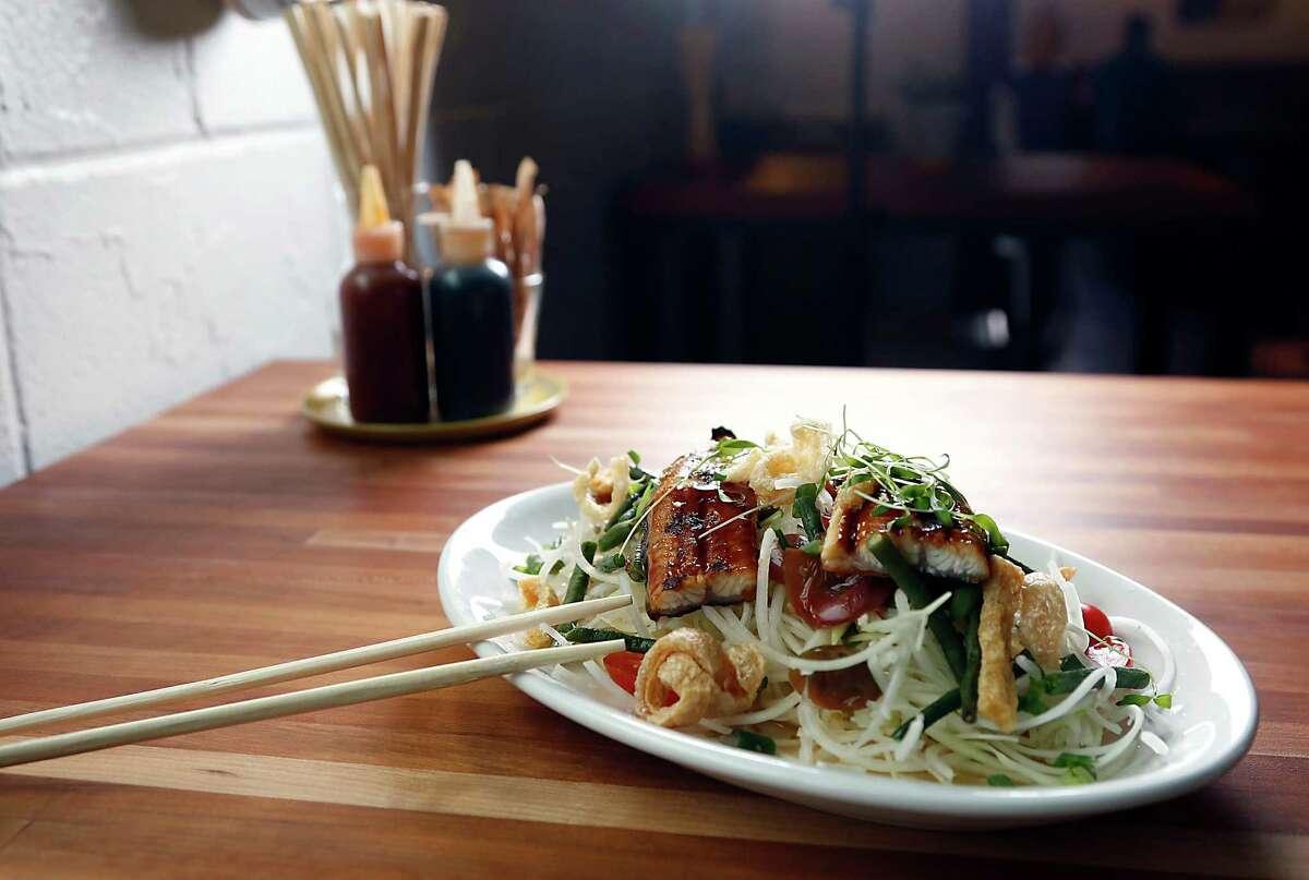 The Green Papaya Salad, long beans, crushed tomato & fish sauce, grilled Japanese mackerel at Lillo & Ella.