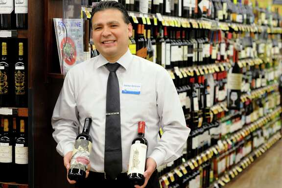 Wine buyer Jaime Deleon with a bottle of Cane and Fable Cab Sav along with a a bottle of The Possessor from Tooth and Nail wines at the Kroger on N. Shepherd Thursday Oct 30 2014.(Dave Rossman photo)
