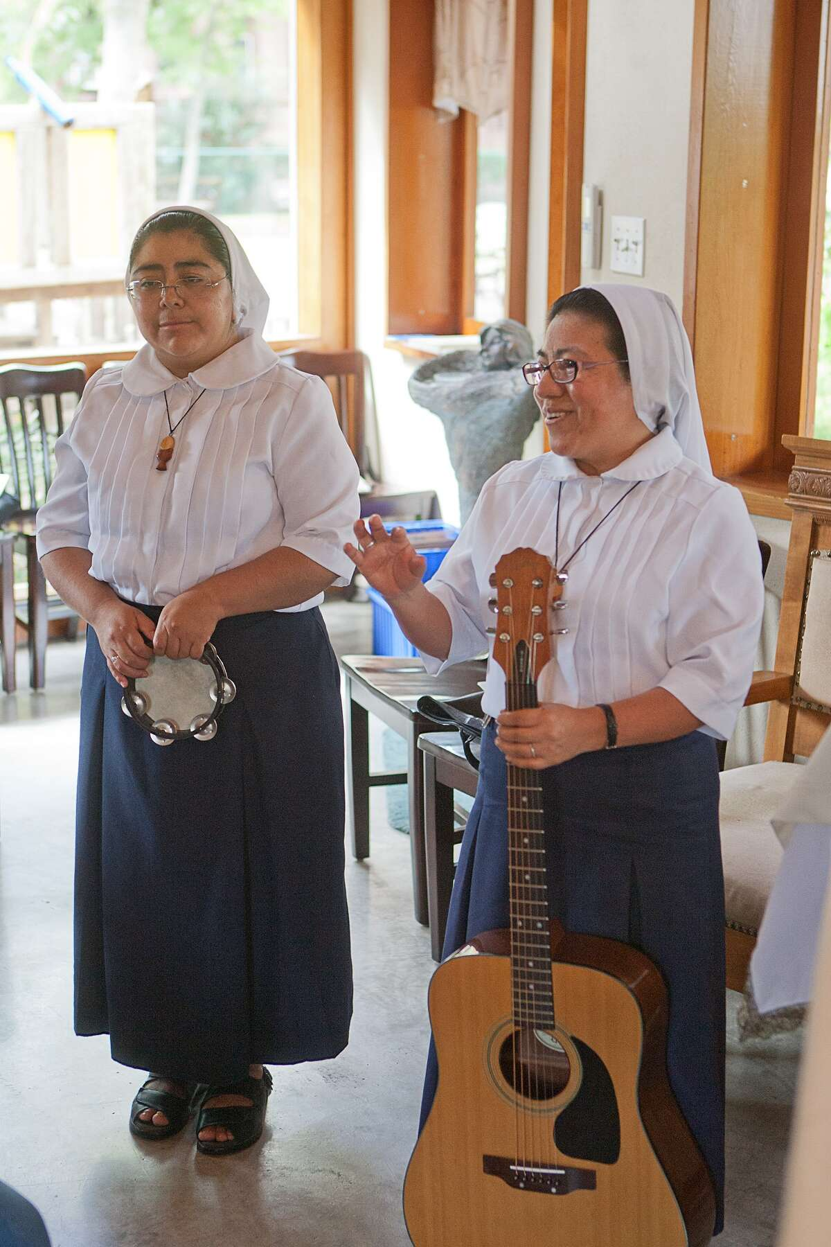 Magnificat House resident and transportation coordinator Larry Burt will carry the altar for the group's Las Posadas celebration. Sister Maria Chali, below at left, and Sister Gabina are involved in planning the event.