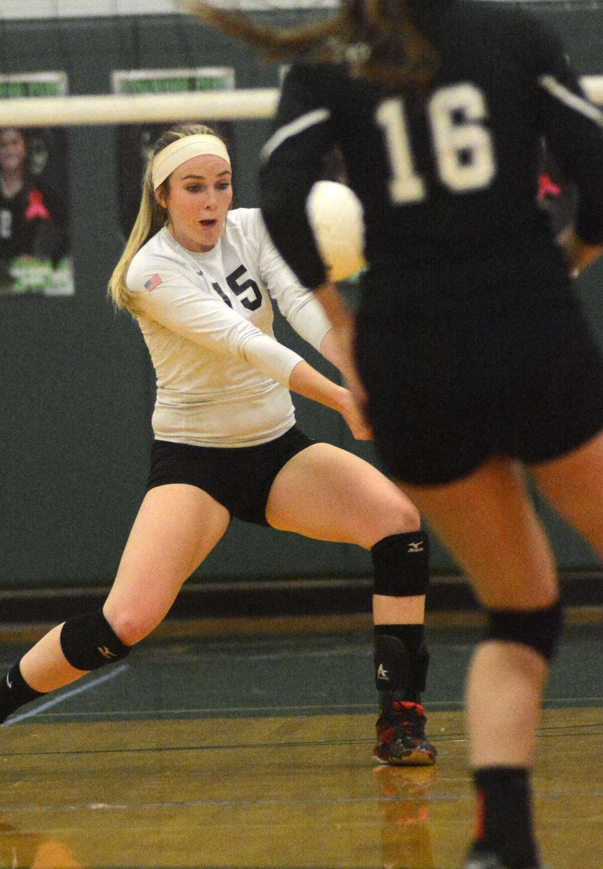Porter senior Libero Jade Strother (15) makes a play against Kingwood Park and junior Jessie Feuerbacher (16) during their match at Kingwood Park High School on Oct. 24th.