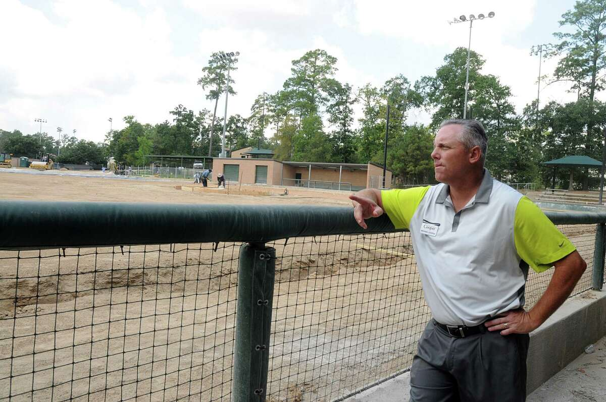 John Cooper School Director of Athletics Mike Cooper watches as workers prepare the John Cooper School baseball field for artificial turf. The school is upgrading its athletic facilities, including softball field with new dugouts, bullpen, and hitting area. Photograph by David Hopper