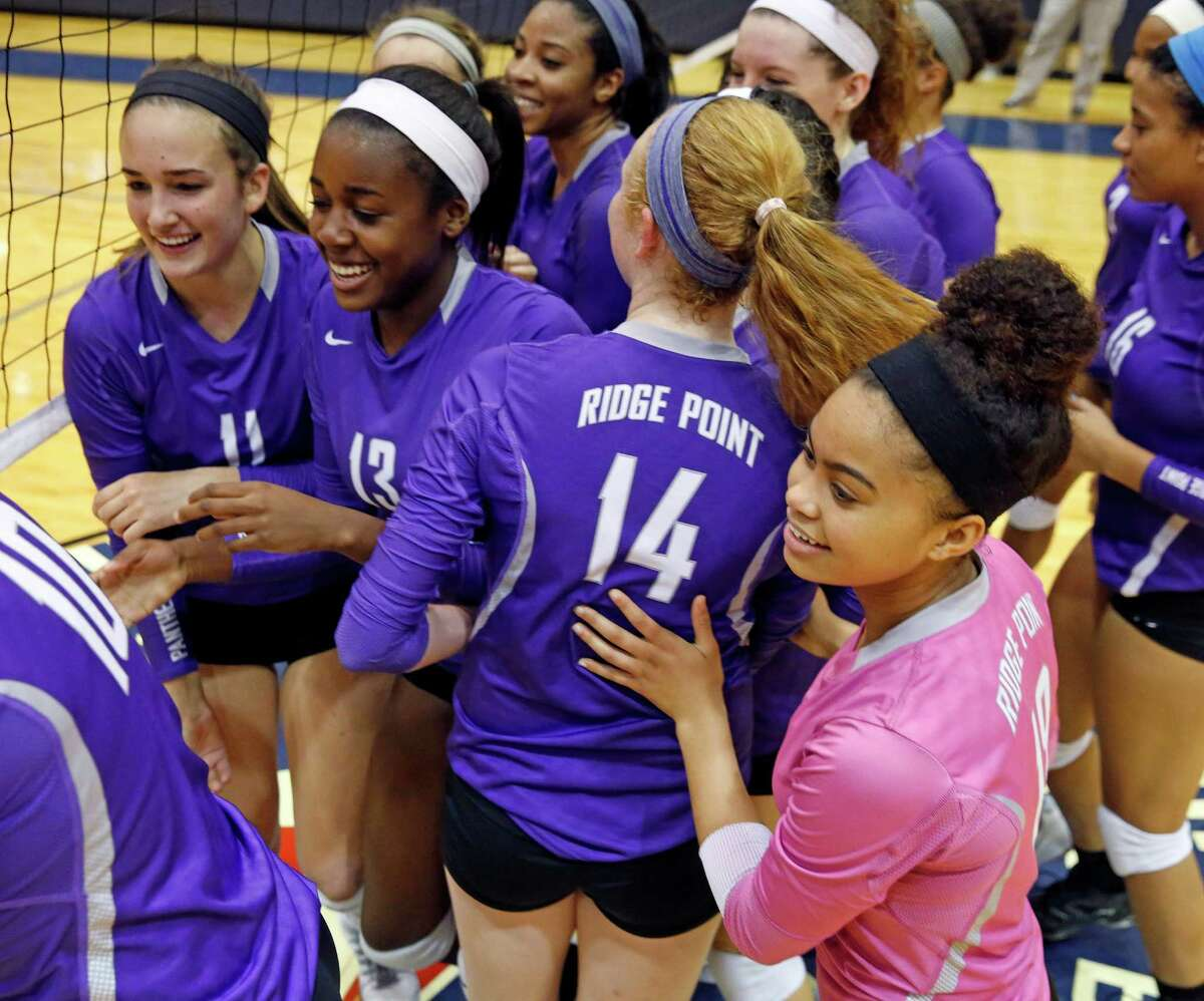 High school playoff match between George Ranch and Ridge Point at Coleman Coliseum, 1050 North Dairy Ashford. ID: Ridge Point players celebrate their hard-fought victory against George Ranch. Tuesday November 11, 2014 (Craig H. Hartley/For the Chronicle)