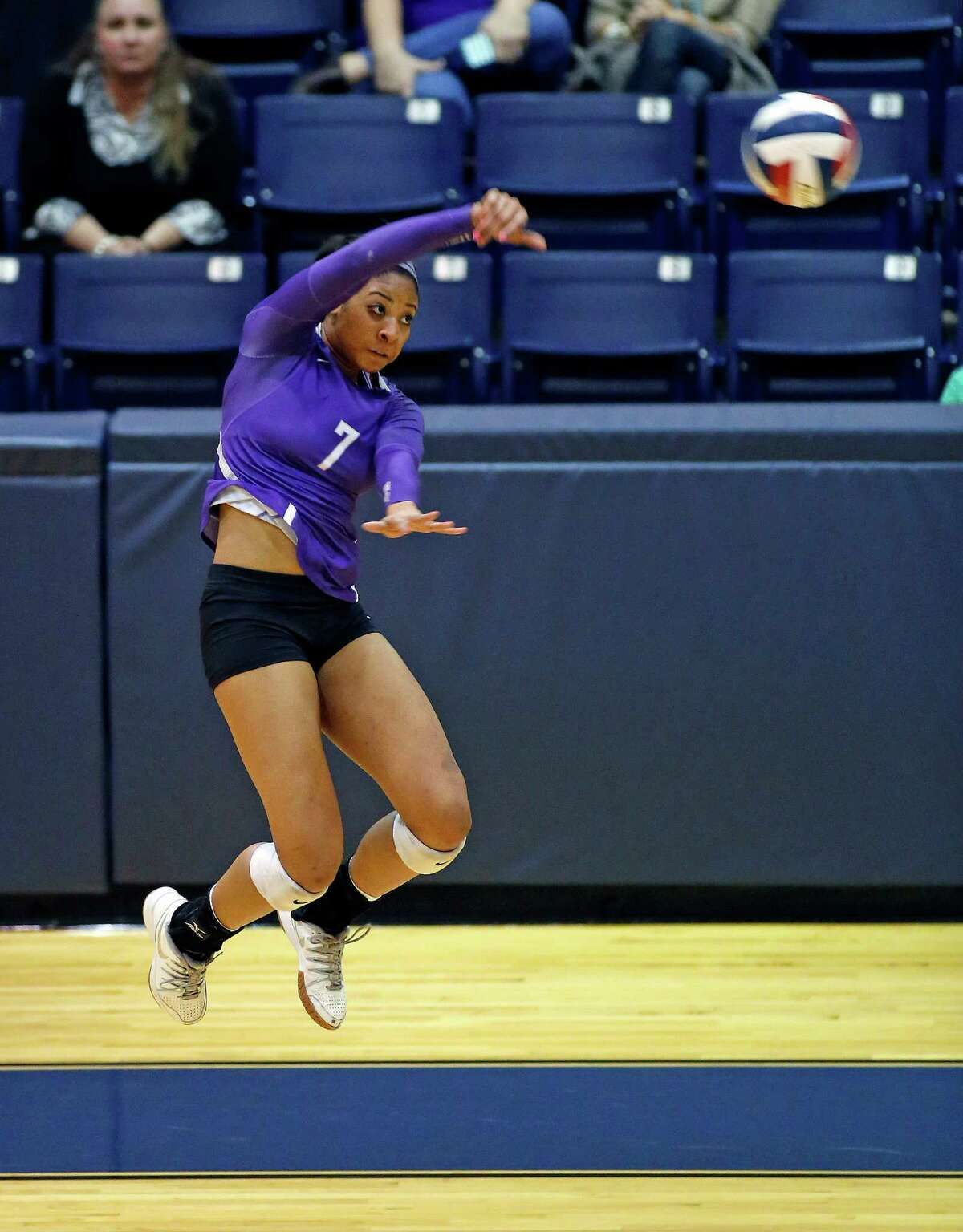 High school playoff match between George Ranch and Ridge Point at Coleman Coliseum, 1050 North Dairy Ashford. ID: Again and again Ridge Point #7 Caitlyn Cooper spikes the ball against her opponents. Tuesday November 11, 2014 (Craig H. Hartley/For the Chronicle)