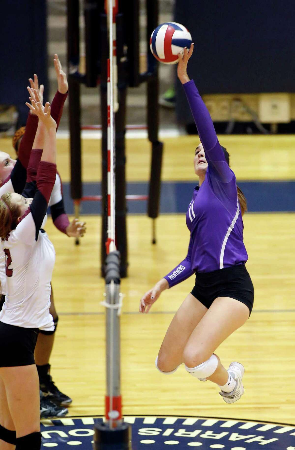 High school playoff match between George Ranch and Ridge Point at Coleman Coliseum, 1050 North Dairy Ashford. ID: Ridge Point #11 Brooke Rutherford returns a shot from the George Ranch Players. Tuesday November 11, 2014 (Craig H. Hartley/For the Chronicle)