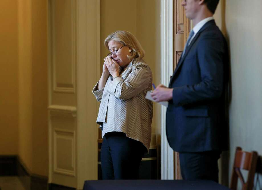 Sen. Mary Landrieu talks on the phone before the Senate vote on the pipeline. Landrieu was pushing the proj  Prior to the Senate's vote on the Keystone XL oil pipeline, Sen. Mary Landrieu, D-La., chair of the Senate Energy and Natural Resources Committee, the bill's sponsor, steps out of a meeting with members of the Democratic caucus to make a phone call, at the Capitol in Washington, Tuesday, Nov. 18, 2014. Landrieu has 59 votes ready and is searching for the last vote needed for approval, both to pass the legislation and to buoy her chances of retaining her Senate seat in a runoff Dec. 6 against Republican Rep. Bill Cassidy. (AP Photo/J. Scott Applewhite) Photo: J. Scott Applewhite / Associated Press / AP