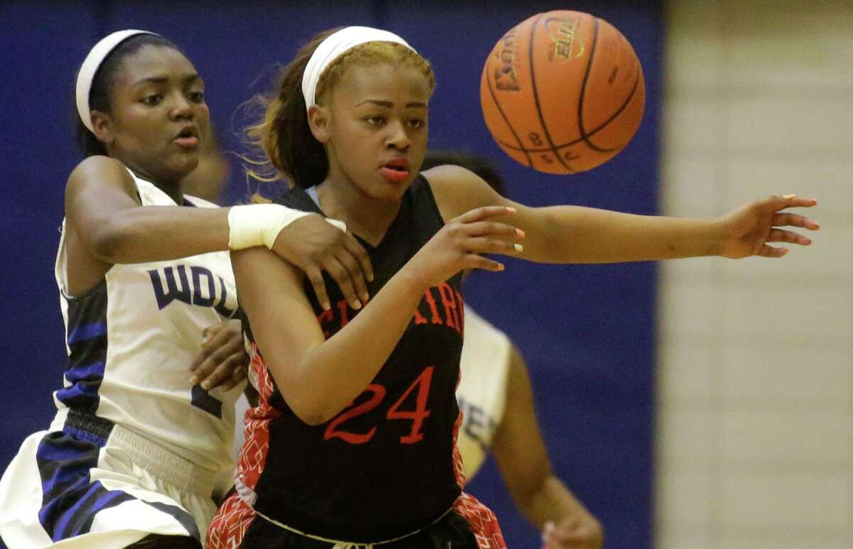 Bellaire's Aeriel Holiday (24) is one of the key returning veterans for Cardinal coach Lamar Simons this season.