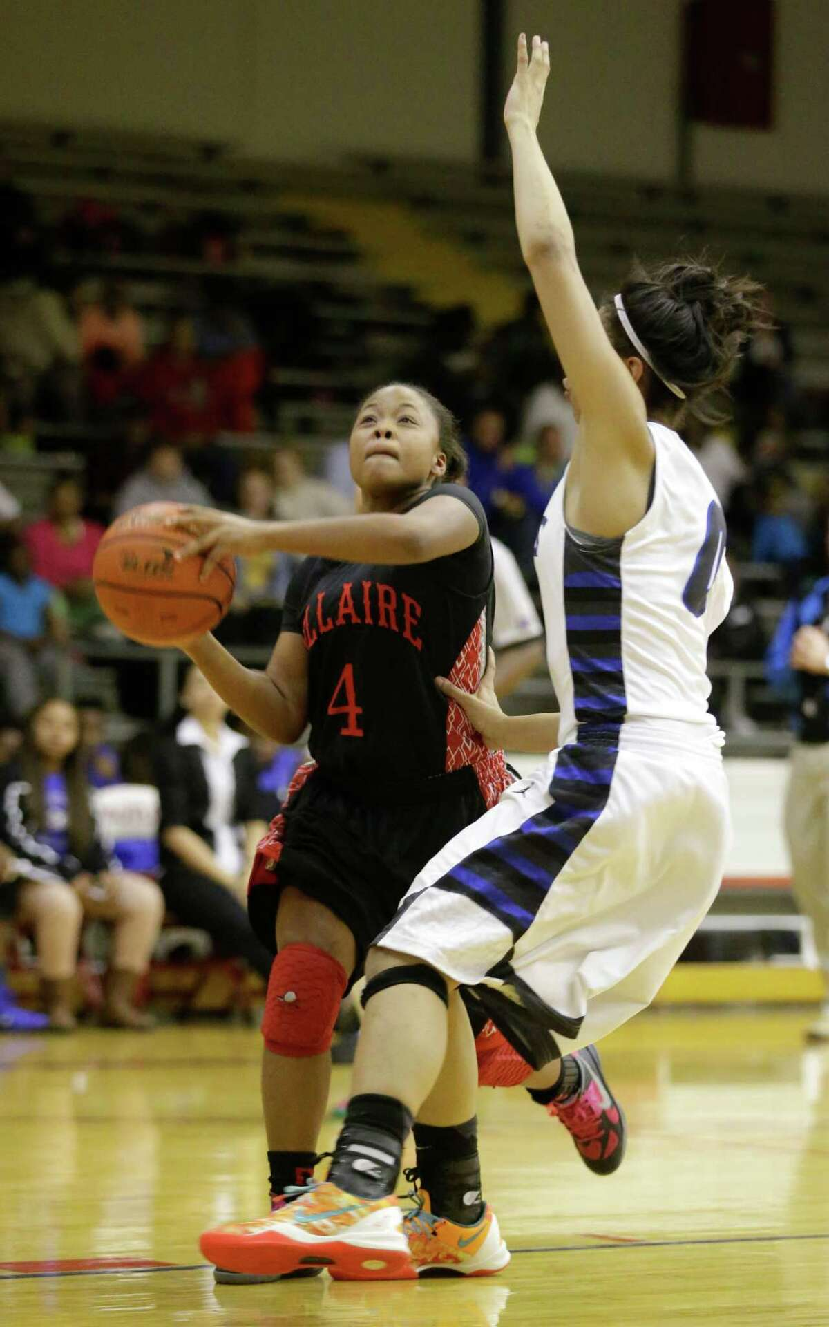 Bellaire's Audrianna Brown (4) shoots over Westside's Ashely Kwartler during the first half of a women's high school basketball game at Butler Field House on Tuesday, Feb. 4, 2014, in Houston. ( J. Patric Schneider / For the Chronicle )