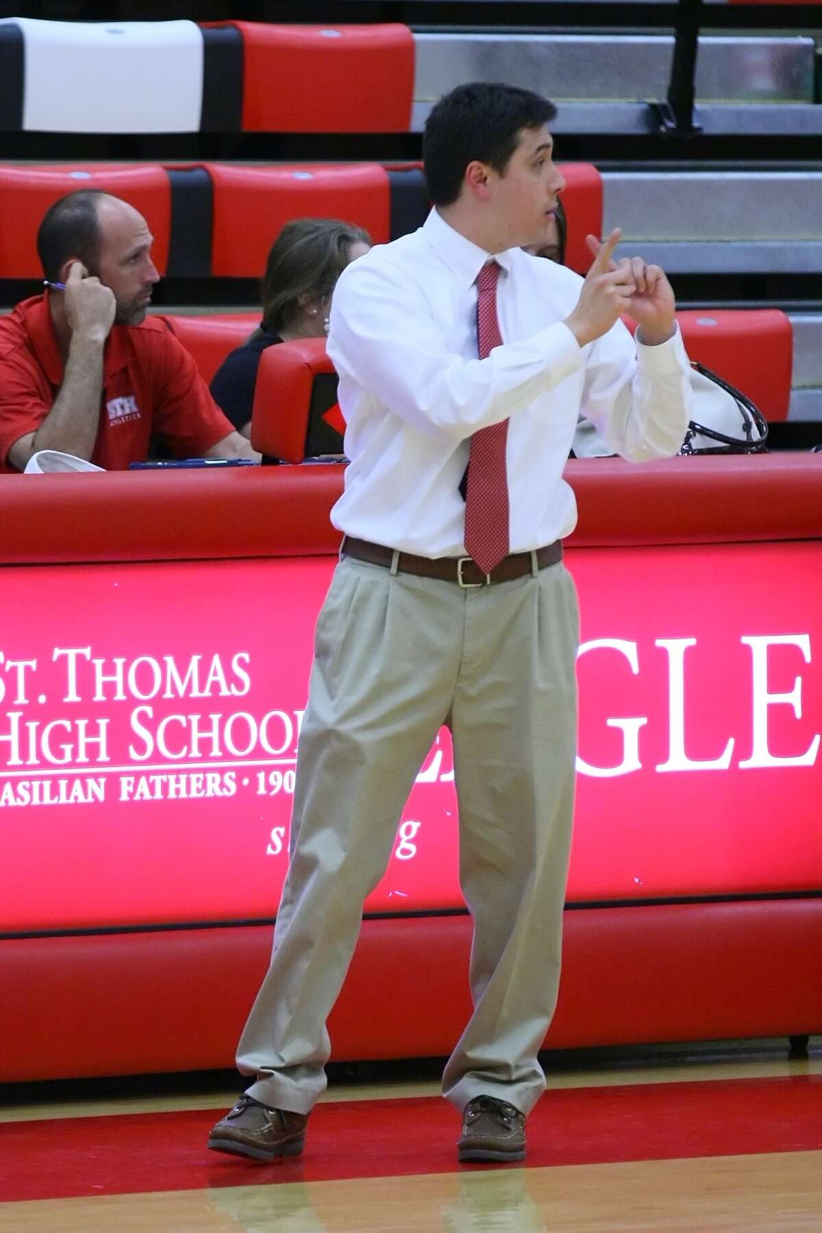 St. Thomas head coach Jonathan Kwok calls a play to his team Tuesday night.