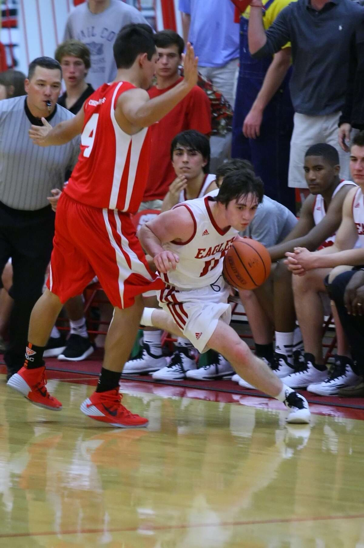 Rock Flowers of St. Thomas cuts his way up the outside as he evades the CHSM defense Tuesday night.