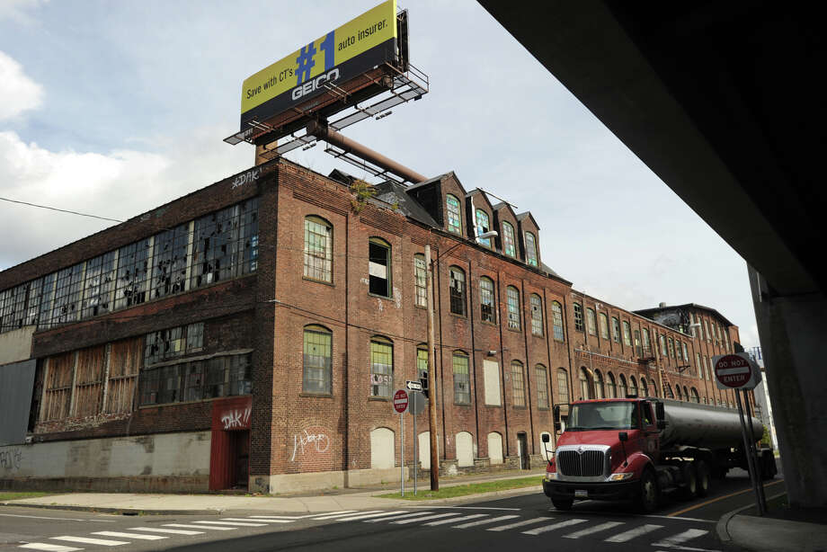 The former Bridgeport Organ Company factory buildings face Interstate 95 across Railroad Ave. between Hancock  and Howard Avenues on the West Side of Bridgeport, Conn. on Tuesday, October 7, 2014. Photo: Brian A. Pounds / Connecticut Post