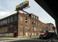 The former Bridgeport Organ Company factory buildings face Interstate 95 across Railroad Ave. between Hancock  and Howard Avenues on the West Side of Bridgeport, Conn. on Tuesday, October 7, 2014.
