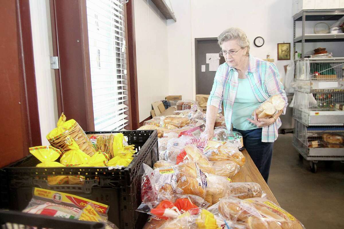 Betty Pridsen at Christian Helping Hands prepares food packages for delivery to people in need.
