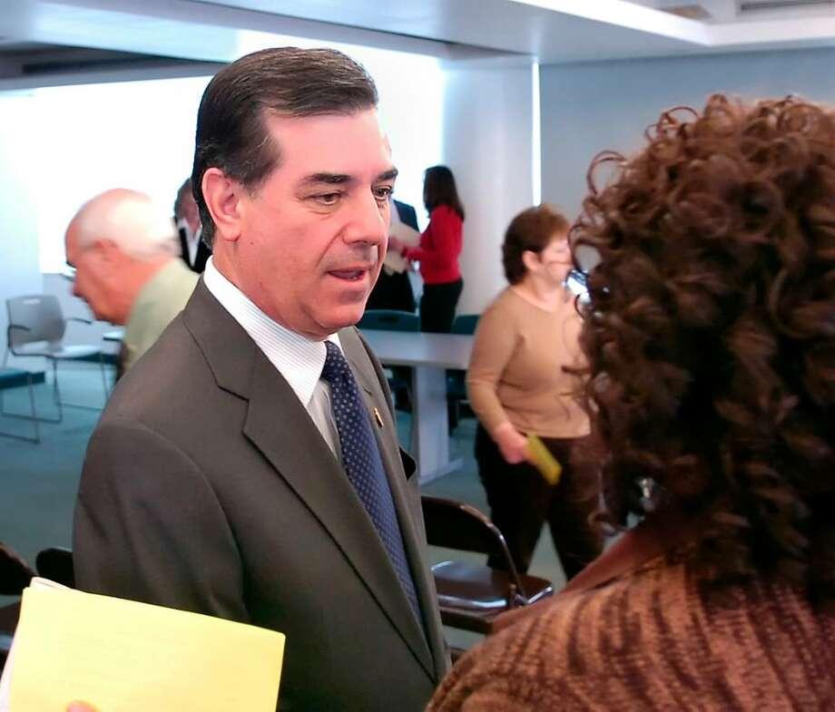 Stamford Mayor Michael Pavia, left, speaks with Stamford Health Dept. employee, Pam Scott. Photo: Bob Luckey, ST / Stamford Advocate