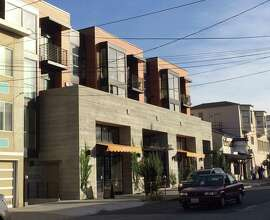 The new building at 1266 9th Ave. in the Inner Sunset, though bold in its use of concrete, is a careful addition to the context of the neighborhood's commercial district. The 19-unit apartment building was designed by Christiani Johnson Architects for Prado Group.