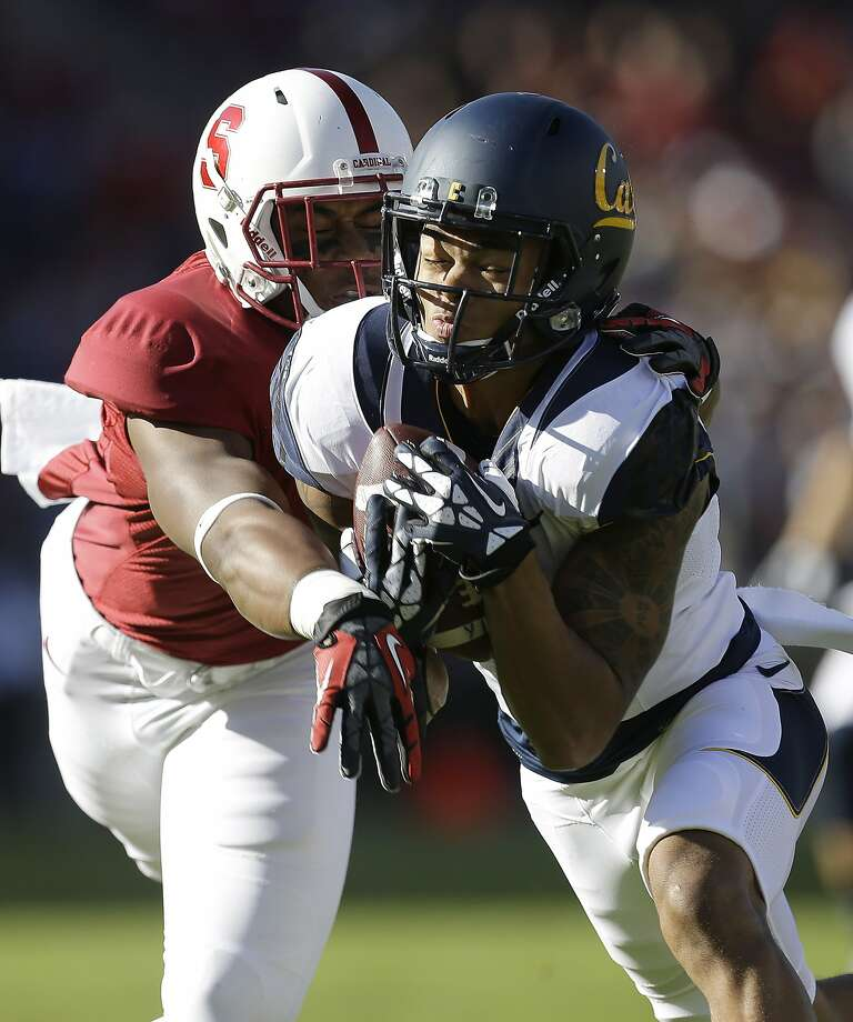 California wide receiver Bryce Treggs (1) miss handles a punt return as he is tackled by Stanford linebacker Blake Martinez (4) during the first half of an NCAA college football game in Stanford, Calif., Saturday, Nov. 23, 2013. (AP Photo/Tony Avelar) Photo: Tony Avelar, AP