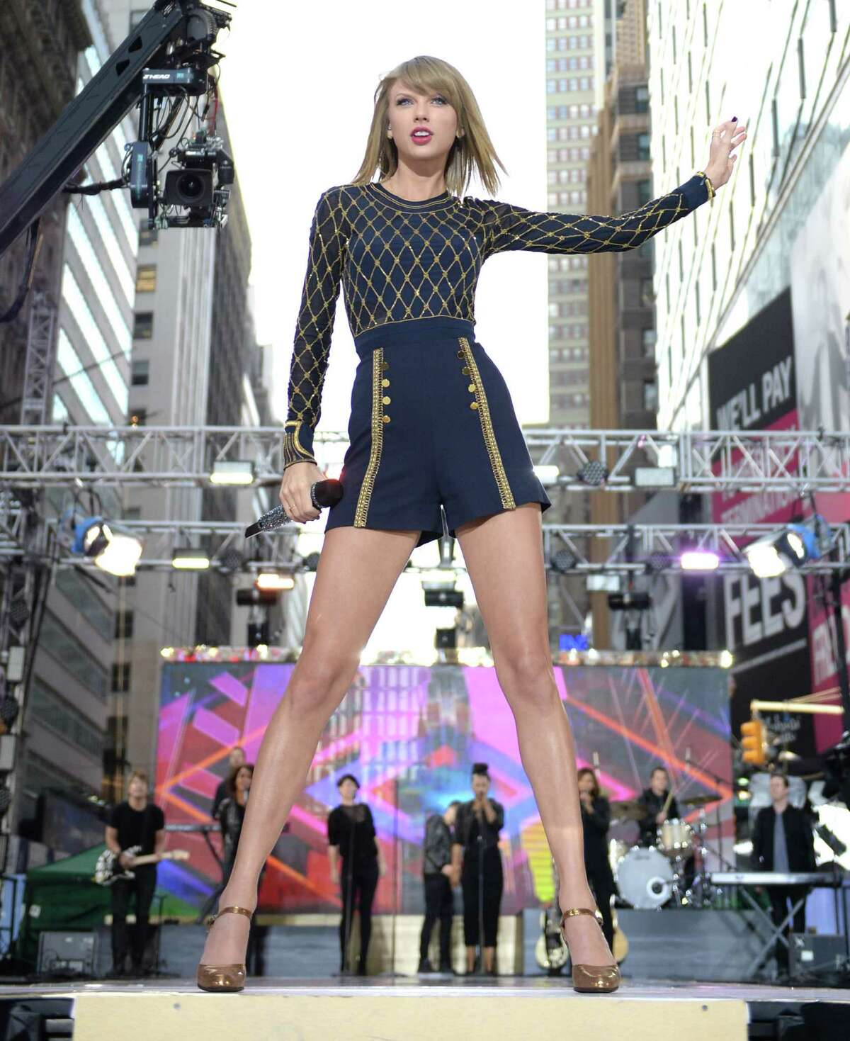 Taylor Swift performs a song from her newest release, 1989, in Times Square on