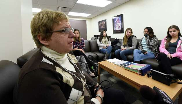 M. Dolores Cimini, Ph.D., left,  speaks about dealing with a death in the University at Albany student body  Tuesday afternoon, Nov. 18, 2014, during a press briefing at the UAlbany in Albany, N.Y. (Skip Dickstein/Times Union) Photo: SKIP DICKSTEIN / 00029538A