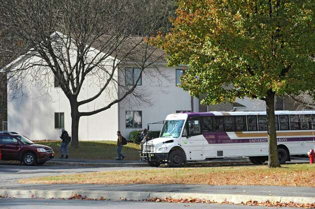 A UAlbany bus lets students off at Freedom Quad, a UAlbany dormitory off Fuller Rd. on Tuesday, Nov. 18, 2014 in Albany,  N.Y. On April 9, Kyle Webb, a 21-year-old student from Port Jefferson in Suffolk County, was found unconscious in his Freedom Quad dorm room on the school?s main campus. (Lori Van Buren / Times Union) Photo: Lori Van Buren / 00029538A