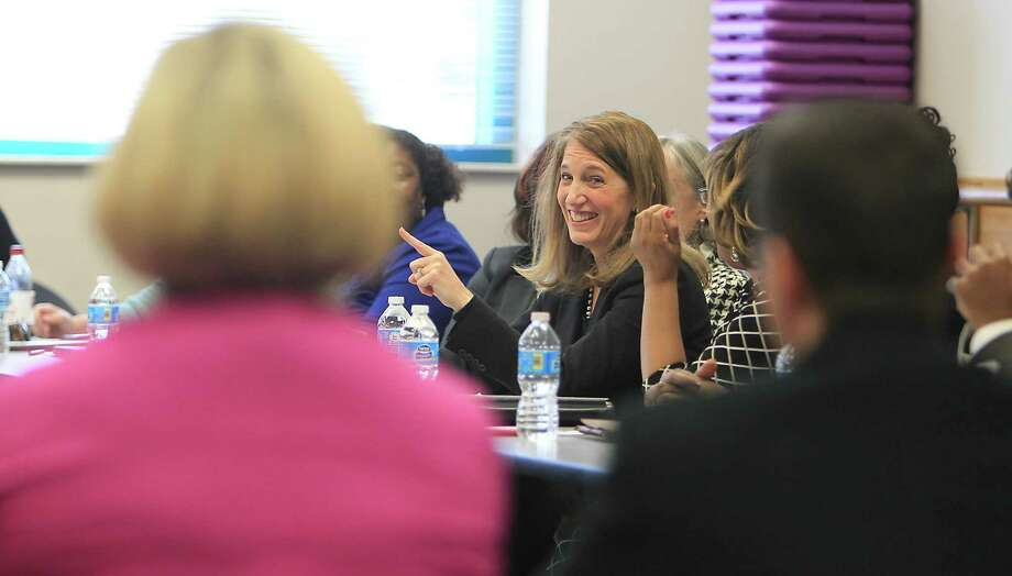Health and Human Services Secretary Sylvia Burwell, center, meets with Houston-area grassroots organizations to help promote enrollment in the  Affordable Care Act. Photo: James Nielsen, Staff / © 2014  Houston Chronicle