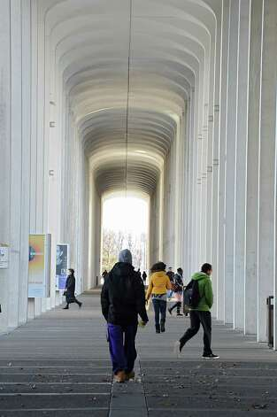 Students walk near the campus center at UAlbany on Tuesday, Nov. 18, 2014 in Albany,  N.Y. (Lori Van Buren / Times Union) Photo: Lori Van Buren / 00029538A