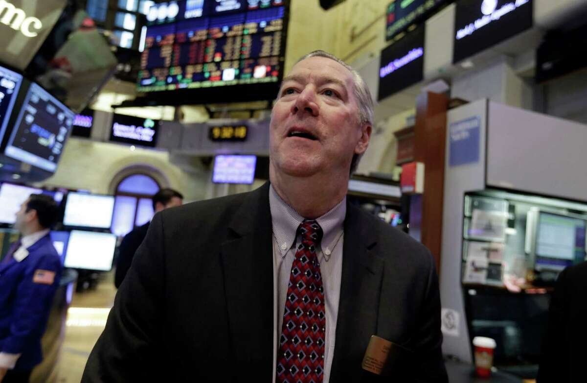Halliburton Chief Executive Dave Lesar, shown in a November visit to the New York Stock Exchange trading floor, took an upbeat tone Tuesday in discussing company finances amid falling oil prices. (AP Photo/Richard Drew)