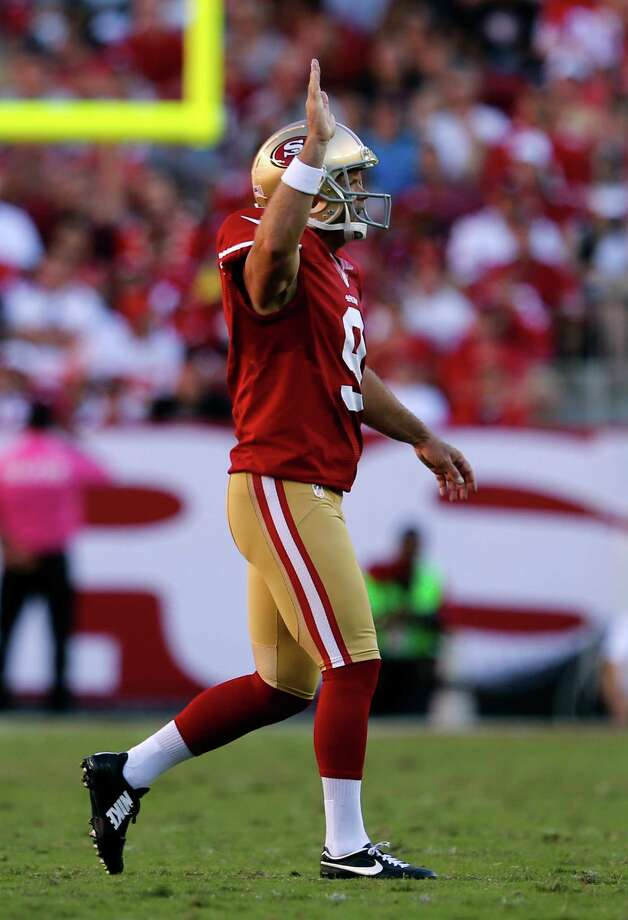 San Francisco 49ers' kicker Phil Dawson signals first down after the  Kansas City Chiefs' were called for too many men on the field on a fourth down during Niners' 22-17 win during NFL game at Levi's Stadium in Santa Clara, Calif. on Sunday, October 5, 2014. Photo: Scott Strazzante / The Chronicle / ONLINE_YES