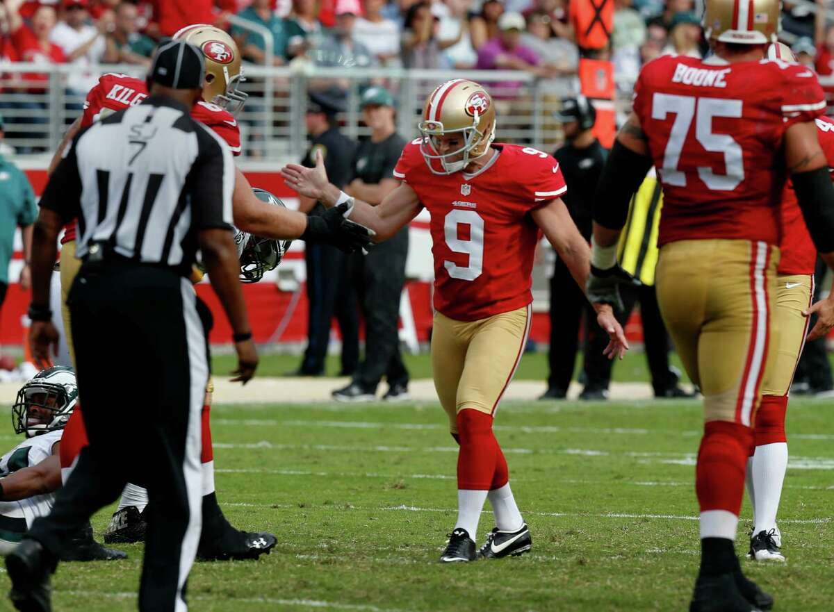 Phil Dawson (9) got congratulated after one of his field goals. The San Francisco 49ers defeated the Philadelphia Eagles 26-21 at Levi's Stadium Sunday September 28, 2014.