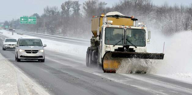 A Kentucky Transportation Cabinet snowplow clears snow on the Pennyrile Parkway just south of the 425 interchange Monday, Nov. 17, 2014. The first winter storm of the season moved through the area Sunday night dumping nearly 5 inches of snow and ice in Henderson County with temperatures expected to be below freezing for the next 2-3 days. (AP Photo/The Gleaner, Mike Lawrence)  ORG XMIT: KYHEN103 Photo: Mike Lawrence / The Gleaner