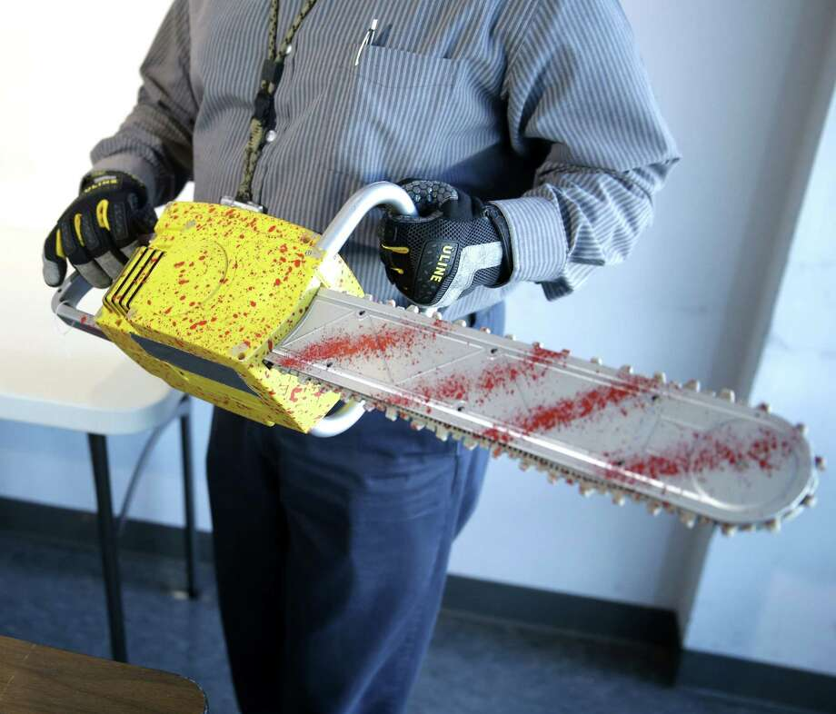 A TSA employee packs away a fake chainsaw after a news conference at John. F. Kennedy Airport in New York, Tuesday, Nov. 18, 2014. The Transportation Security Administration displayed thousands that were confiscated from carry-on bags over three months at New York's Kennedy Airport. The TSA wants to remind the public what carry-on items were no-no's. Photo: Seth Wenig, Associated Press / AP