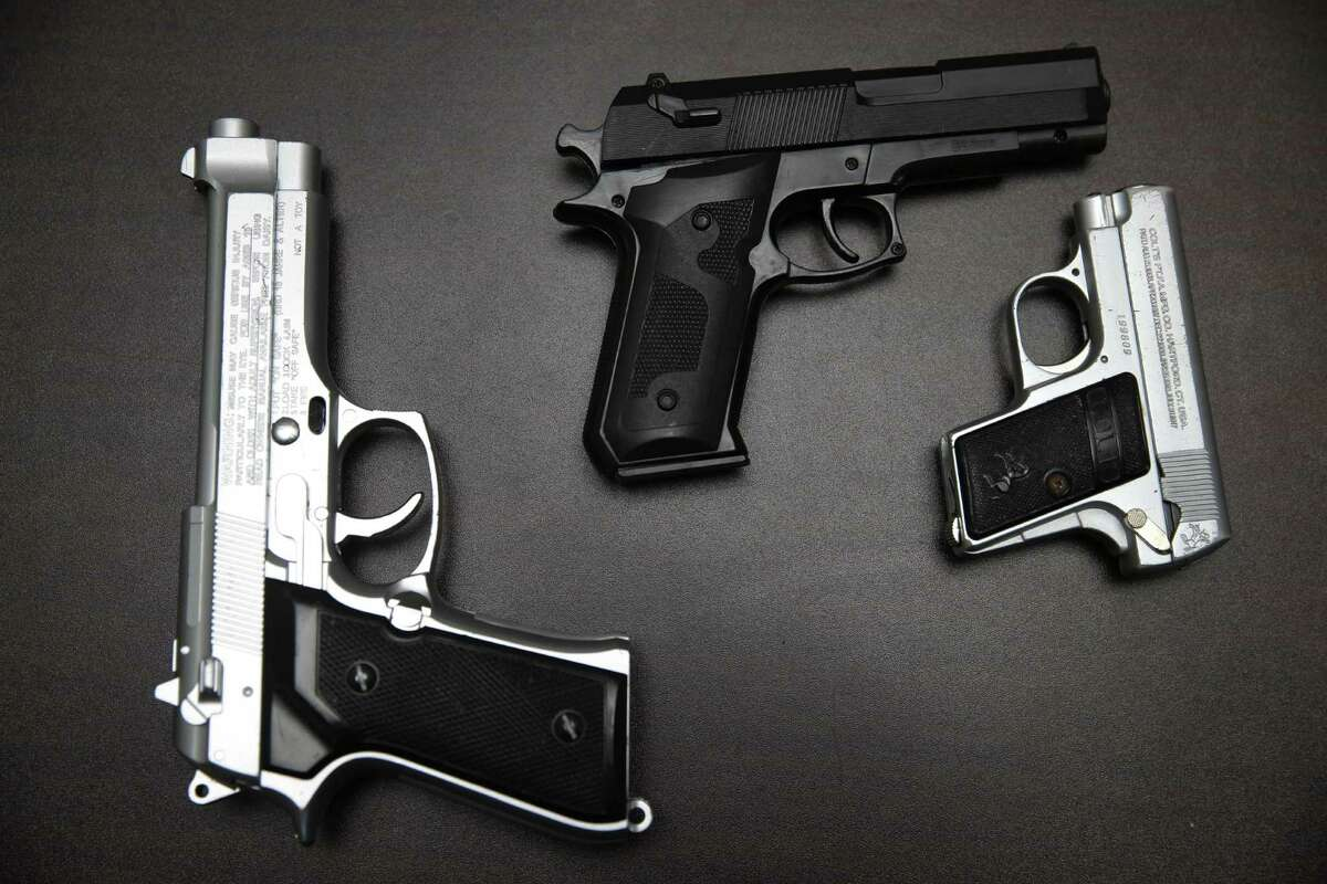 Fake guns are displayed with other prohibited carry-on items during a news conference at John. F. Kennedy Airport in New York, Tuesday, Nov. 18, 2014.
