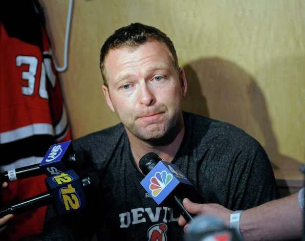 FILE - In this April 14, 2014, file photo, New Jersey Devils goaltender Martin Brodeur talks to the media as the NHL hockey team clean out their lockers in Newark, N.J. Brodeur isn't burning up his phone trying to find a place to play. While he lets his agent do that leg work, the legendary goaltender keeps working out and skating as much as he can in the hopes that his NHL career isn't over. Brodeur is the all-time leader in wins (688) and shutouts (124) and won three Stanley Cups with the Devils (1995, 2000 and 2003). (AP Photo/Bill Kostroun, File) ORG XMIT: NY166 Photo: Bill Kostroun / FR51951 AP