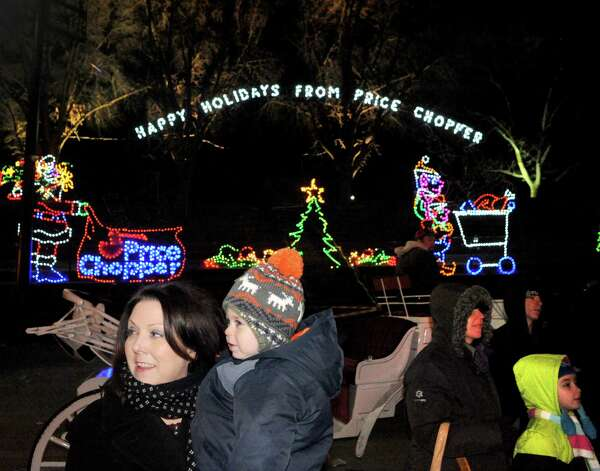 Kate Hedgeman of Albany, left, and her two-year-old son Brendan Hedgeman watch as the as the lights go on during the kickoff holiday lights in the park at Washington Park on Tuesday Nov. 18, 2014 in Albany, N.Y. (Michael P. Farrell/Times Union) Photo: Michael P. Farrell / 00029530A