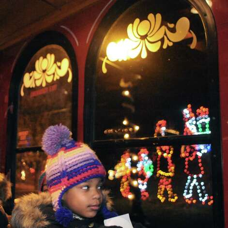 Six-year-old Zoe Crawford of Albany was on the first trolley tour on during the kickoff holiday lights in the park at Washington Park on Tuesday Nov. 18, 2014 in Albany, N.Y. (Michael P. Farrell/Times Union) Photo: Michael P. Farrell / 00029530A