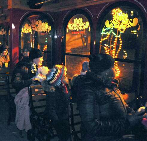 Six-year-old Ava Crawford of Albany, center, was on the first trolley tour on during the kickoff holiday lights in the park at Washington Park on Tuesday Nov. 18, 2014 in Albany, N.Y. (Michael P. Farrell/Times Union) Photo: Michael P. Farrell / 00029530A