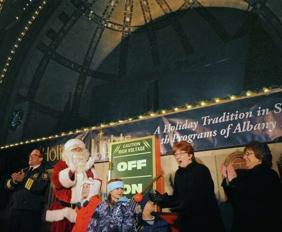 Albany Police Chief Steve Krokoff, left, Santa Claus, Mayor Kathy Sheehan and Mona Golub on hand during the kickoff holiday lights in the park at Washington Park on Tuesday Nov. 18, 2014 in Albany, N.Y. (Michael P. Farrell/Times Union) Photo: Michael P. Farrell / 00029530A