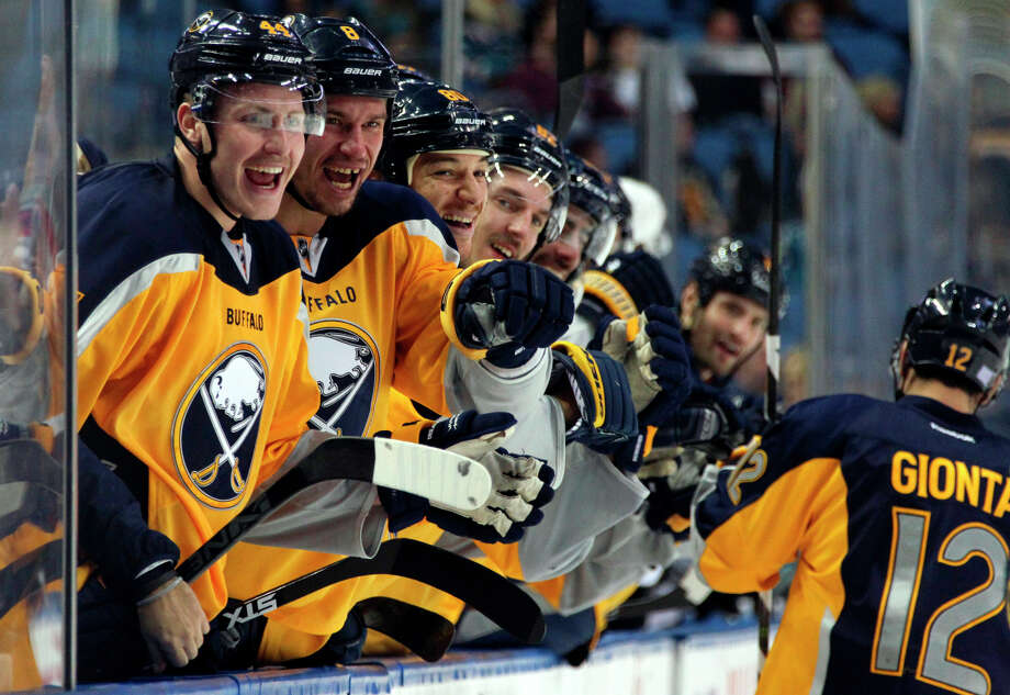 The Sabres' bench celebrates a goal by Brian Gionta (12) against the Sharks during the second period. Photo: Jen Fuller / Associated Press / FR171262 AP