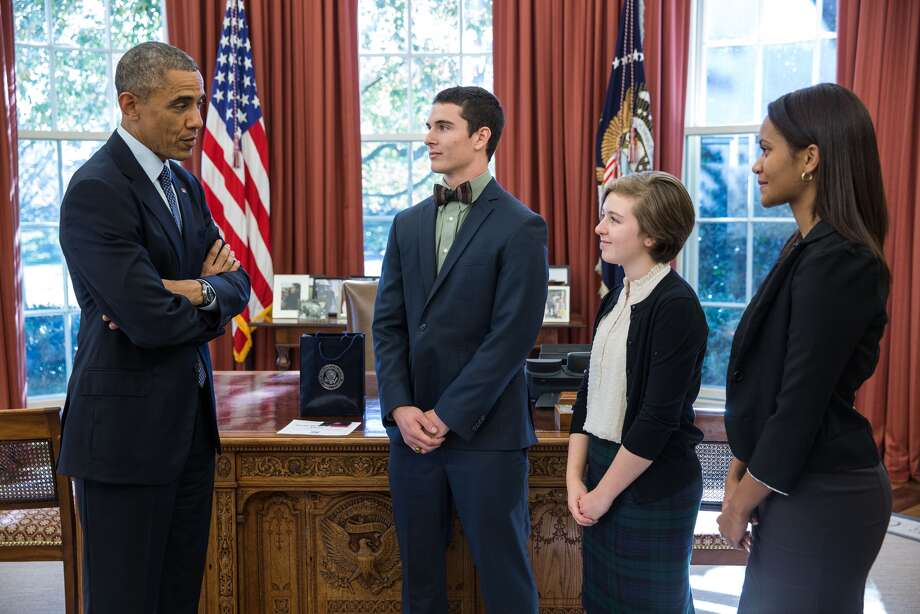 President Barack Obama greets the winners of the 2014 National Youth Network Entrepreneurship Challenge, in the Oval Office of the White House, Nov. 18, 2014. The President greets from left:  runner up Jesse Horine, 19, from Fort Mill, S.C.; first place winner Lily DeBell, 13, from Baltimore, Md., and Rrunner up Ambar Romero, 16, from Bridgeport, Conn. (Official White House Photo by Pete Souza)