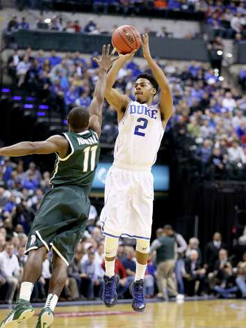 INDIANAPOLIS, IN - NOVEMBER 18: Quinn Cook #2 of the Duke Blue Devils shoots the ball during the game against the Michigan State Spartans in the State Farm Champions Classic at Bankers Life Fieldhouse on November 18, 2014 in Indianapolis, Indiana.  (Photo by Andy Lyons/Getty Images) ORG XMIT: 522173143 Photo: Andy Lyons / 2014 Getty Images