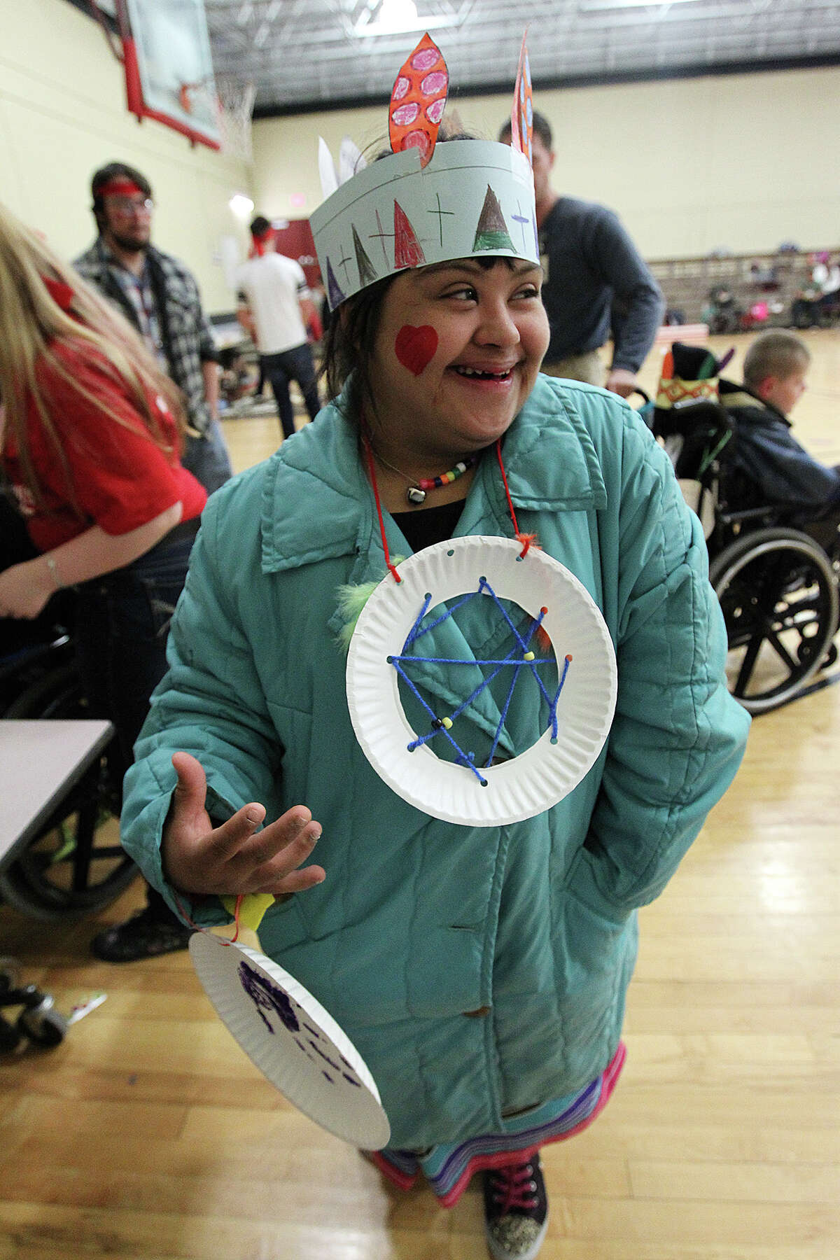 """Christma Rodriguez, 17, wears her dreamcatcher as a necklace during the Southside Independent School District's """"Friendship Feast"""" at the ACES Early College Academy."""