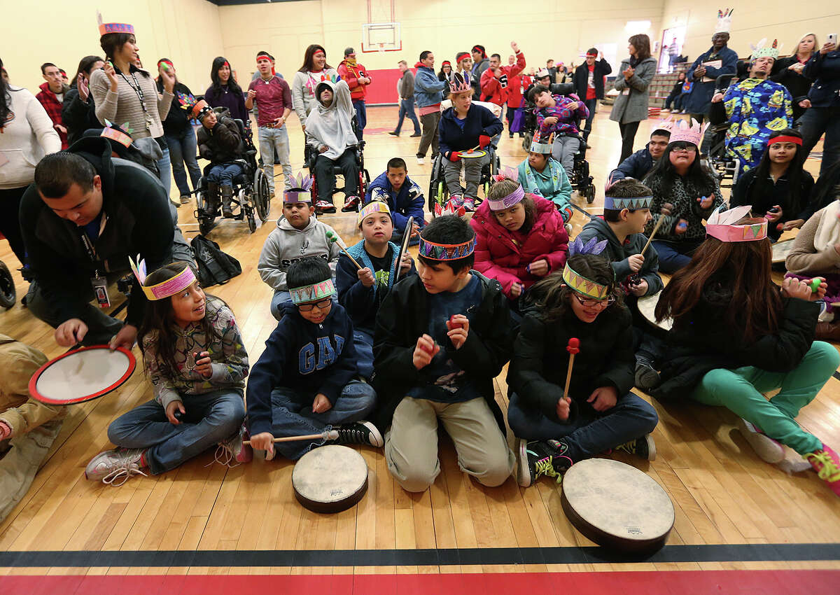 Students participate in a drum session - a huge hit at the feast.