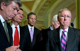 From left, Sen. Roy Blunt, R-Mo., Sen. John Barrasso, R-Wyo., Sen. John Thune, R-S.D., Senate Minority Whip John Cornyn of Texas, and Senate Minority Leader Mitch McConnell of Ky., pause during a news conference on Capitol Hill in Washington, Tuesday, Nov. 18, 2014. President Barack Obama does not support a Senate push to approve the Keystone XL oil pipeline from Canada to the Texas Gulf coast, White House press secretary Josh Earnest said Tuesday, hours before a scheduled vote.