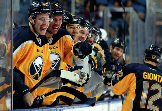 Buffalo Sabres' Nicolas Deslauriers (44), Cody McCormick (8) and Chris Stewart (80) celebrate a goal by Brian Gionta (12) against the San Jose Sharks during the second period of an NHL hockey game Tuesday, Nov. 18, 2014, in Buffalo, N.Y. (AP Photo/Jen Fuller) ORG XMIT: NYJF Photo: Jen Fuller / FR171262 AP