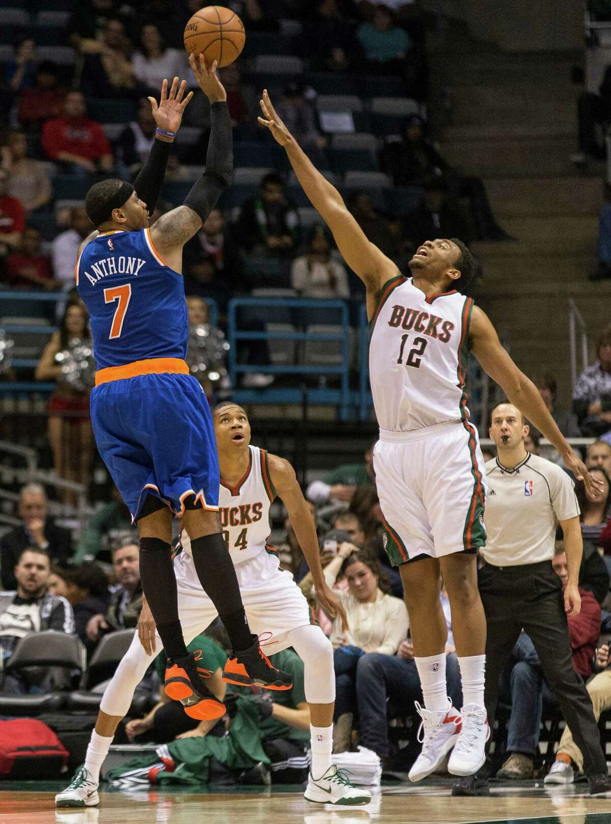 New York Knicks' Carmelo Anthony shoots over Milwaukee Bucks' Jabari Parker during the second half of an NBA basketball game Tuesday, Nov. 18, 2014, in Milwaukee. (AP Photo/Tom Lynn) ORG XMIT: WITL107