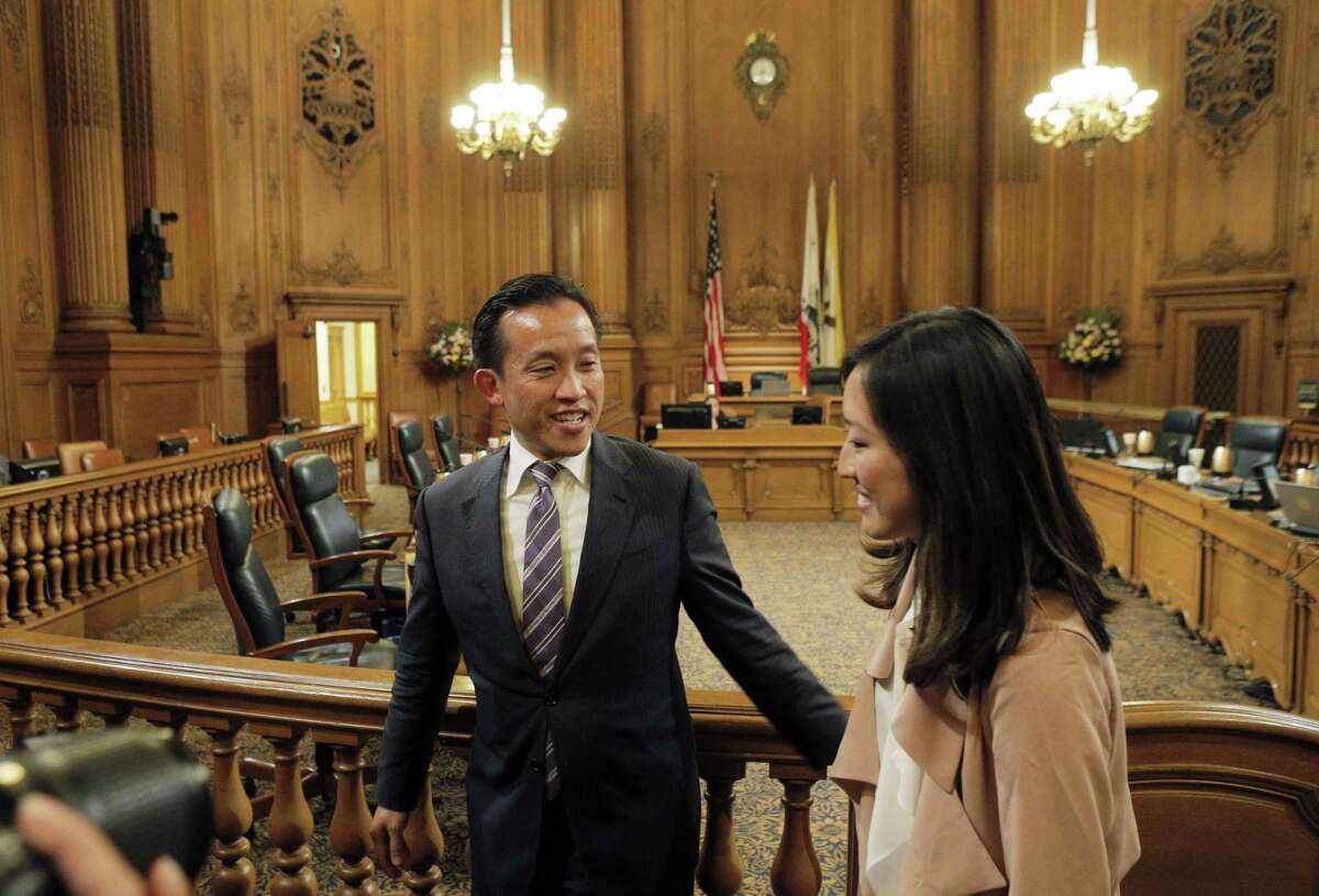 Board of Supervisors President David Chiu walks out of chambers with newly-elected interim Board President Katy Tang following her selection on Tuesday. San Francisco Supervisors elected an interim board president on Tuesday, November 18, 2014, naming Katy Tang to replace David Chiu who will be stepping down to join the state assembly in December. The selection took place during the Board of Supervisors meeting at City Hall in San Francisco, Calif.