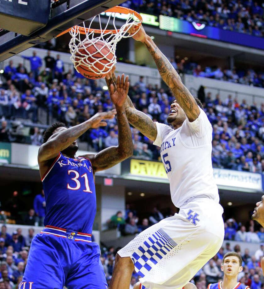 Kentucky's Willie Cauley-Stein (right) dunks over Kansas' Jamari Traylor (31) in the Wildcats' win. Photo: Mark Cornelison / McClatchy-Tribune News Service / Lexington Herald-Leader
