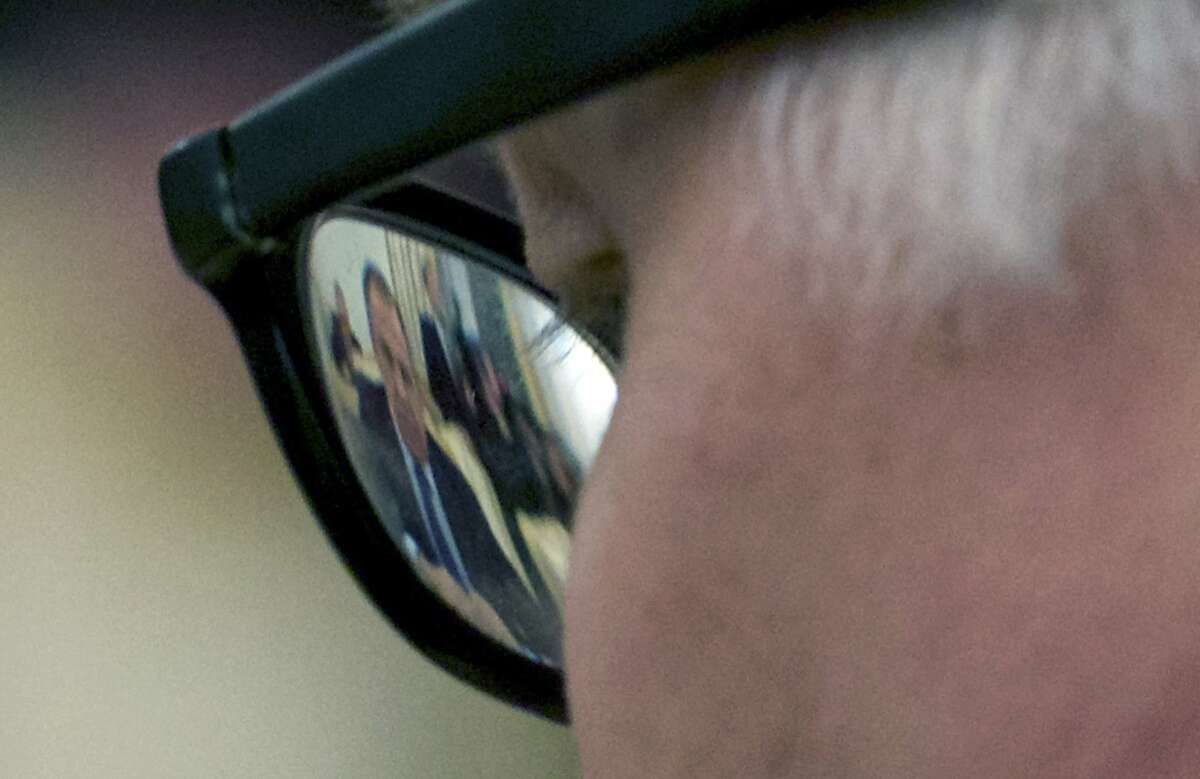 Russian Foreign Minister Sergey Lavrov is seen through German Foreign Minister Frank-Walter Steinmeier's glasses during their talks in Moscow, Russia, Tuesday, Nov. 18, 2014. German Foreign Minister Frank-Walter Steinmeier, who is shuttling between Kiev and Moscow on Tuesday, urged the Ukrainian government and pro-Russian separatists to respect their cease-fire agreement, which has helped to halt ground combat but failed to stop daily artillery exchanges. (AP Photo/Ivan Sekretarev)