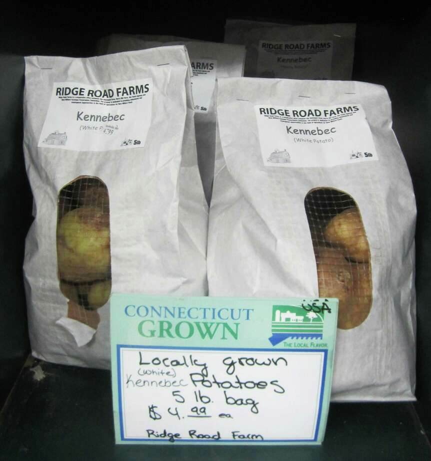 Potatoes grown at Ridge Road Farm in New Milford are sold at Northville Store along Litchfield Road (Route 202) in town. November 2014 Photo: Norm Cummings / The News-Times